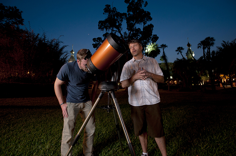 Associate professor Simon Schuler assists a student in using one of UT's computerized telescopes.