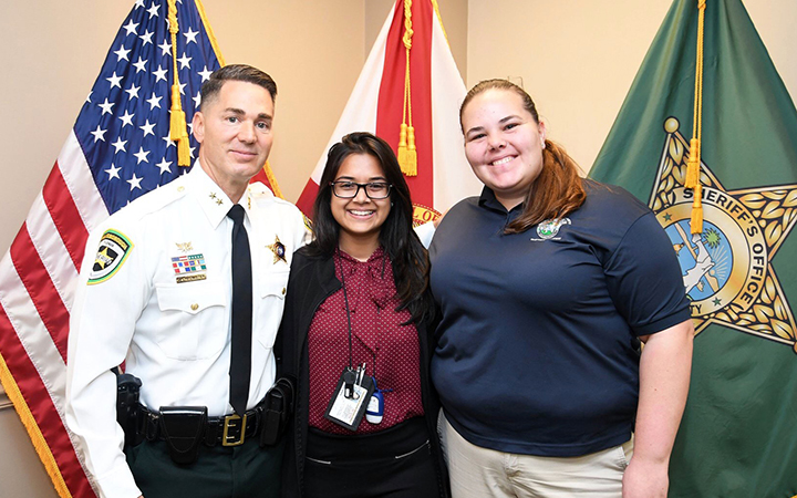 UT student takes a photo with Hillsborough County Sheriff Chad Chronister as part of her internship.