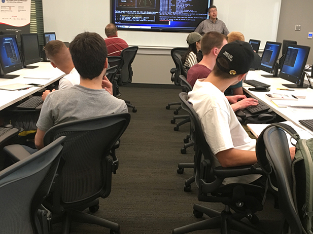 A classroom with computer work stations in the College of Business.