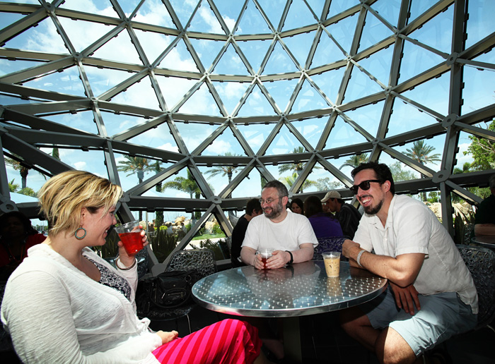 MFA mentors Maile Chapman and Mikhail Iossel sit with Nathan Deuel during an outing at the Salvador Dali Museum.