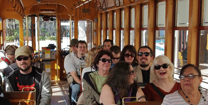 MFA students and faculty on a streetcar for a walking seminar about the lectores—the famous readers of the cigar factories.