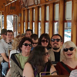 MFA students and faculty on a streetcar <br/>for a walking seminar about the lectores<br/>—the famous readers of the cigar factories.