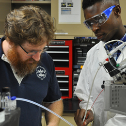 Gaston Merideth II '18 has been working since his first <br />year at UT with Kenyon Evans-Nguyen, associate professor <br />of chemistry, on finding ways to analyze <br />forensic evidence quickly while in the field. <br />