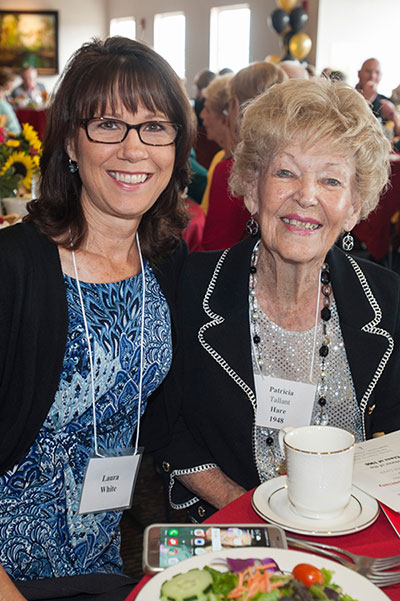 Alumni attend the President's Reception on the East Verandah of Plant Hall during Homecoming weekend.