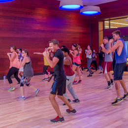 The fitness center offers a minimum<br/> of 50 group fitness classes throughout the week.<br/>
