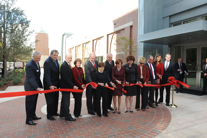 UT friends and donors cut the ribbon to open the center.