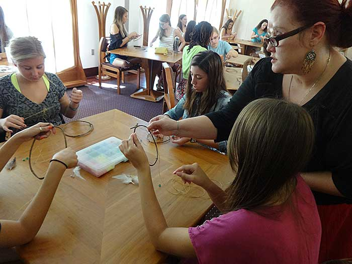 Students create dream catchers, believed by Native Americans to catch bad dreams and wash them away with the sun.