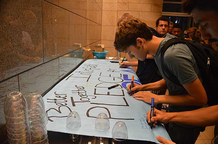 Students join together to sign a Pledge for Peace and participate in a candlelight walk around the campus.