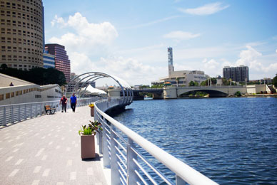 The Tampa Riverwalk is a 2.5 mile pedestrian<br/> space connecting downtown's popular destinations<br/> and the city's vibrant business community.<br/>