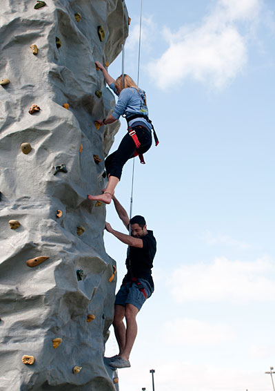Students participate in a on-campus rocking climb event sponsored by the Spartan Climbers.