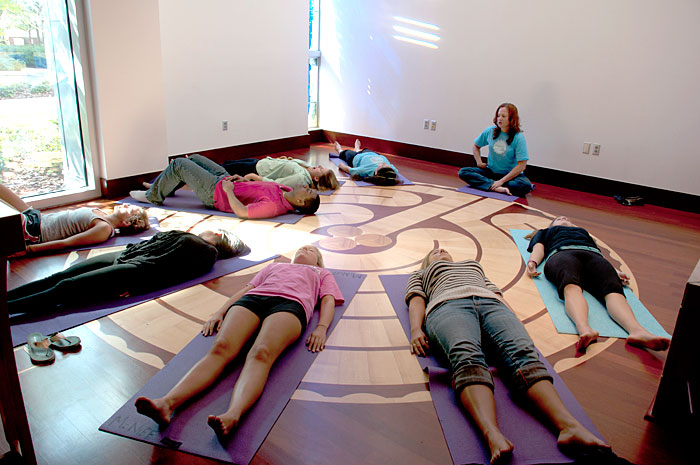 Students participate in a Yoga class in one of the Sykes Chapel's Labyrinth meditation rooms.