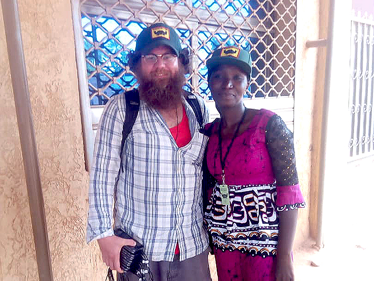 Professor Kevin Fridy and a research assistant in Burkina Faso