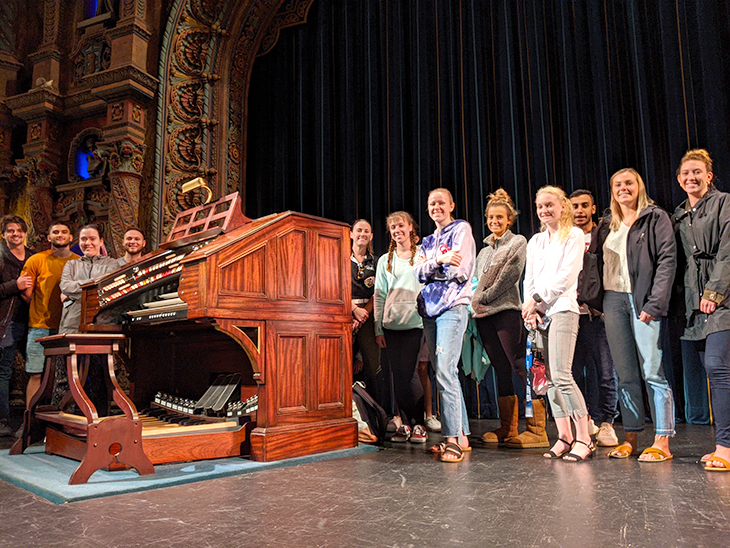 Students in Management 431: Practical Strategic Assessment take a tour of the Tampa Theatre.