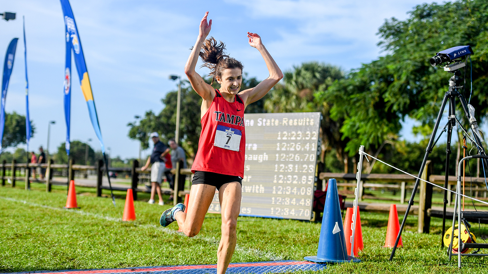 Zoe Jarvis running across a finish line