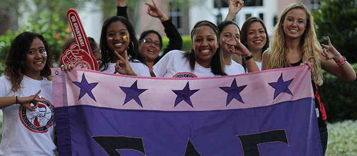 Sorority sisters holding their flag